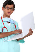 Boy dressed as a doctor — Stock Photo