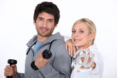Couple with weights and email symbol — Stock Photo