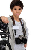 Young boy as a press photographer — Stock Photo