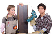 Children dressed as carpenters — Stock Photo