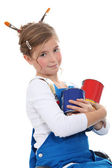 Little girl in dungarees with paint cans — Stock Photo