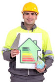 A mason showing energy class chart — Stock Photo