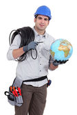 Electrician wiring the world — Stock Photo