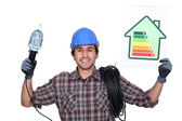 Electrician with a house energy rating sign — Stock Photo