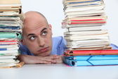 Man overwhelmed with folders — Stock Photo