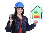 Electrician with an energy rating card — Stockfoto