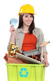 Woman making money by recycling — Stock Photo