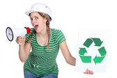 Female builder encouraging to recycle — Stock Photo