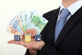 Businessman holding bank notes — Stok fotoğraf