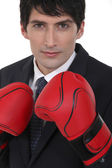 Executive wearing boxing gloves — Stock Photo