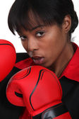Black woman with boxing gloves — Stock Photo