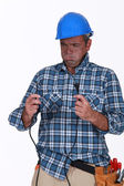 Untrained electrician getting a shock — Stock Photo