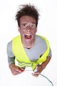 Electrician having an electric shock — Stock Photo