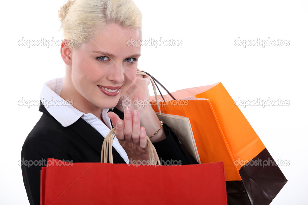 Businesswoman with store bags — Stock Photo #9723404
