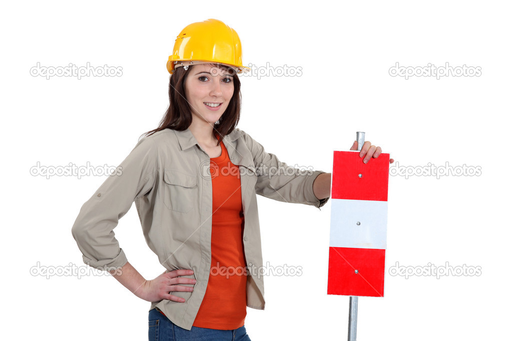 Brunette stood with warning sign — Stock Photo #9726114