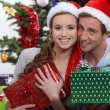 Couple with Christmas gifts — Stok fotoğraf
