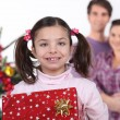 Young family at Christmas — Stock Photo #9740982