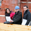 Stock Photo: Architect and clients visiting site