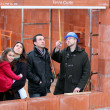 Royalty-Free Stock Photo: Family and contractor on construction site
