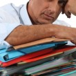 Man with pile of paperwork — Foto de Stock
