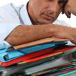 Man with pile of paperwork — Stock Photo