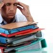 Man with stack of work - Stock Photo