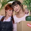 Girls on moving day — Stock Photo