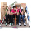 Unhappy housemates cleaning their flat before moving out — Stock Photo #9741857