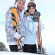 Couple about to ski down mountain — Stock Photo #9741935