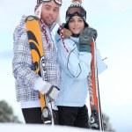 Couple about to ski down mountain — Stock Photo