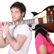 Guitarist covering his band mate's face — Stock Photo