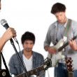 Young rock band with female vocalist — Stock Photo