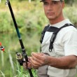 Stock Photo: Fishermwith rod