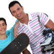 Father and teenager enjoying sport together - Stock Photo