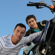 Man and teenager watching motorbike — Stock Photo
