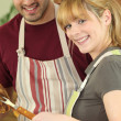 Couple cooking meat — Stock Photo #9743468