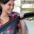 Young Asian woman getting in her car — Stock Photo