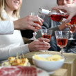 Stock Photo: Friends having informal dinner party