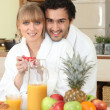Couple having breakfast in your bathrobe — Stock Photo