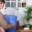 Woman with plastic bottle for recycling — Stock Photo