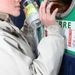 Woman recycling glass bottles — Stock Photo
