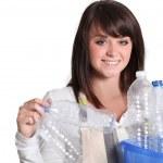 Woman gathering plastic bottles — Stock Photo