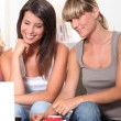Young women browsing on the Internet — Stock Photo