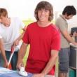 Stock Photo: Boys cleaning the house