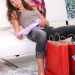Woman examining her purchases — Stock Photo #9745250