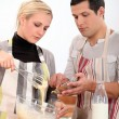 Couple preparing recipe — Foto Stock #9745957