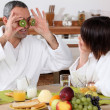 Couple having breakfast in bathrobe — Stock Photo