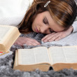 Female student sleeping amid books — Stock Photo