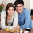 Portrait of young couple in a kitchen — Stock Photo