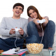 Young couple playing to video games — Stock Photo #9747209